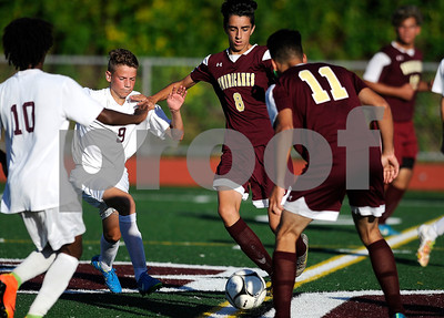 10/10/2017 Mike Orazzi | Staff Bristol Central's Adam Jones (9) and New Britain's John Morell (8) during Tuesday's soccer at Bristol Central.
