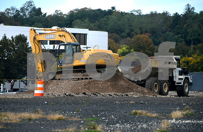 10/10/2017 Mike Orazzi | Staff Work being done on the new road in Centre Sqaure in downtown Bristol Tuesday.