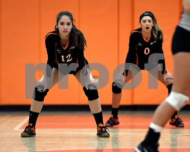 10/11/2017 Mike Orazzi | Staff Terryville's Alyssa Prozzo (12) and Cara Andrews  (0) during Wednesday night's match with Northwestern.