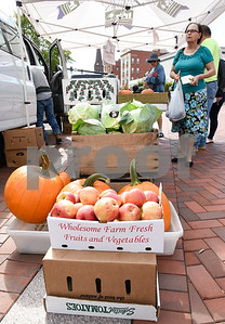 10/11/17  Wesley Bunnell | Staff  Apples and pumpkins for sale among other fresh produce at Dondero Orchards mobile stand at the New Britain Farmers' Market in Central Park on Wednesday afternoon.
