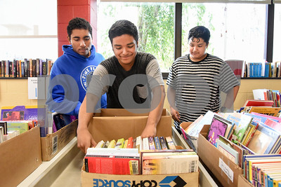 10/11/17  Wesley Bunnell | Staff  Sponsored by the Friends of the The New Britain Public Library their annual fall book sale is taking place this Thursday through Saturday.  Volunteers Jomar Vazquez, Jose Mortaya and brother Vicente Mortaya help organize books.
