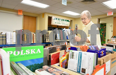 10/11/17  Wesley Bunnell | Staff  Sponsored by the Friends of the The New Britain Public Library their annual fall book sale is taking place this Thursday through Saturday. Member of the Friends of the New Britain Public Library Susan Holland looks through the book selection.
