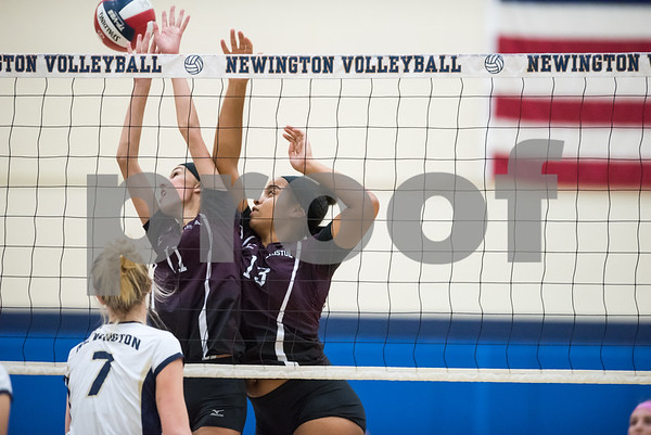10/12/17 Wesley Bunnell | Staff Bristol Central vs Newington girls volleyball at Newington High School on Thursday evening. Bristol Central freshman Emily Ericson (11) and senior Xia'ian Carrasco (13).