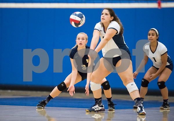 10/12/17 Wesley Bunnell | Staff Bristol Central vs Newington girls volleyball at Newington High School on Thursday evening. Newington sophomore Carelys Benitez (13) is backed up by senior captain Blayne Wanner-Hyde (3).