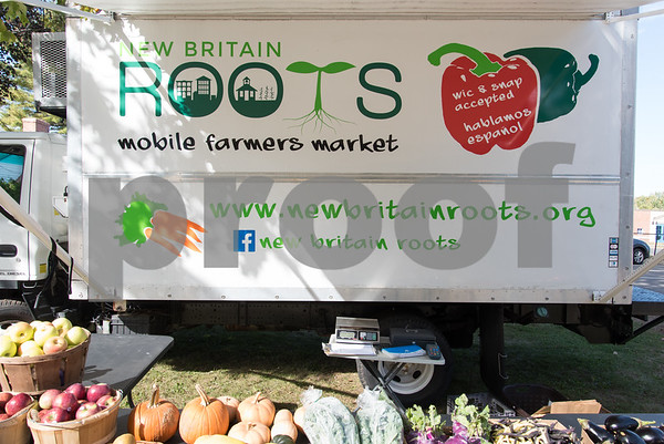 10/12/17 Wesley Bunnell | Staff New Britain ROOTS set up their mobile farmers market outside of Slade Middle School on Friday afternoon.