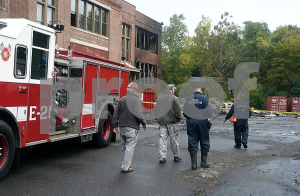 10/14/2017 Contributed photos The scene of a large blaze at the old O'Connell elementary school, police said. The fire was called in at 1:08 a.m. by several people, police said. Firefighters arrived to find a &quote;large scale&quote; working fire that heavily damaged the building and some building materials, police said. No injuries were reported. The cause of the fire is under &quote;active investigation,&quote; according to police who declined to give out further details. Council members voted to sell the old elementary school at 120 Park St. for redevelopment in 2015. The school has not been used since 2012. The plan was to turn the old school into 49 units of housing which was supposed to be finished in spring of 2017.