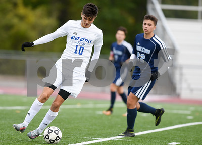 10/16/17  Wesley Bunnell | Staff  Middletown vs Plainville boys soccer at Plainville High School on Monday afternoon. Plainville's Patrick Whronowski (10).