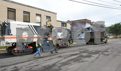 10/16/17  Wesley Bunnell | Staff  A large asphalt milling machine works its way down Church St in Bristol on Monday afternoon.