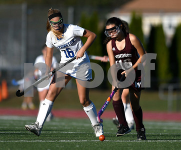 10/17/2017 Mike Orazzi | Staff Southington's Lauren Graef (16) and Windsor's Lindsay Shonte (16) during field hockey with Windsor Tuesday at SHS.