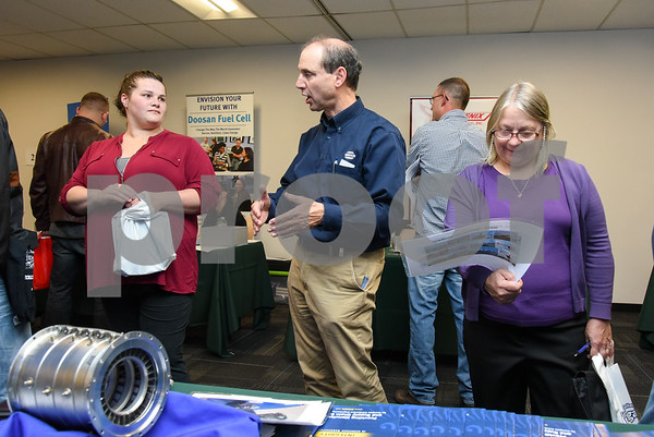 10/17/17 Wesley Bunnell | Staff Goodwin College in East Hartford held a Manufacturing Career Fair Tuesday evening to help address the needs of local manufacturers who struggle to find skilled manufacturing workers. Jennifer Labulis, L, of Springfield Mass speaks with Continuous Improvement Manager Eric Schneider of Birken Manufacturing in Bloomfield.