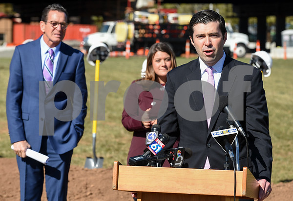 10/17/17 Wesley Bunnell | Staff An official groundbreaking ceremony was held on Tuesday morning for the Columbus Commons transit orientated development site on Columbus Ave which is the site of the former police station. Tim Sullivan, DECD Deputy Commissioner speaks as Governor Dannel Malloy and Mayor Erin Stewart look on.