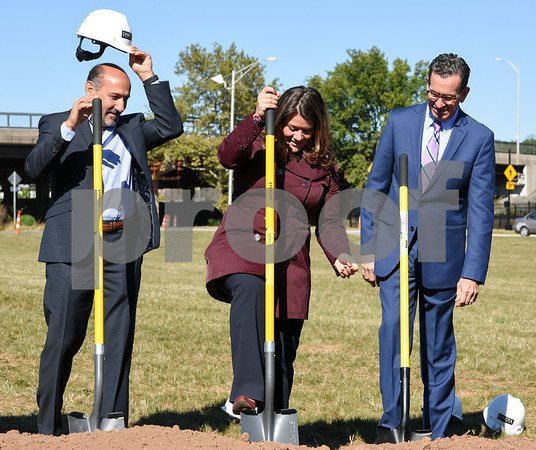 10/17/17 Wesley Bunnell | Staff An official groundbreaking ceremony was held on Tuesday morning for the Columbus Commons transit orientated development site on Columbus Ave which is the site of the former police station. Roberto Arista from Dakota Partners watches as Mayor Erin Stewart pushes her shovel back into the ground with Governor Dannel Malloy looking on.