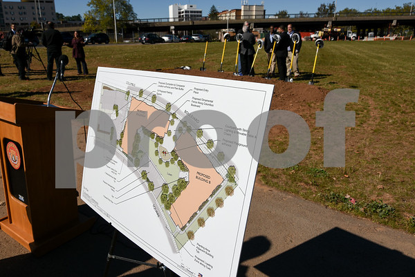 10/17/17 Wesley Bunnell | Staff An official groundbreaking ceremony was held on Tuesday morning for the Columbus Commons transit orientated development site on Columbus Ave which is the site of the former police station. Plans for the development are shown.