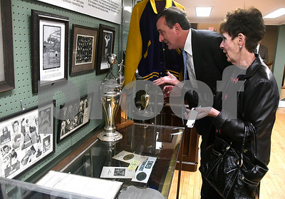 "10/17/2017 Mike Orazzi | Staff Pete Santago and Terri Carmody look at sports memorabilia during a ""Meet the Candidates"" event at the Southington Historical Society Tuesday night."