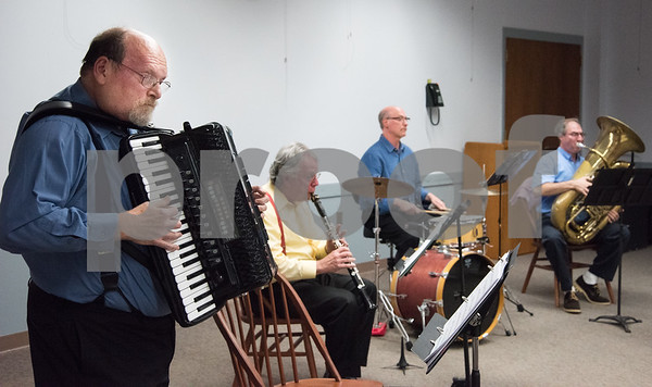 10/18/17 Wesley Bunnell | Staff The New Britain Symphony Orchestra Polka Ensemble played for a large crowd at the Berlin Public Library on Wednesday evening. Michael Schiano on the accordion, Walter Mamlok on clarinet and David Edricks on percussion and David Schweitzer on tuba.