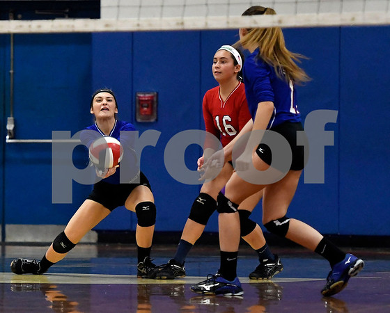 10/18/2017 Mike Orazzi | Staff St. Paul's Emma McPhee (1), Olivia Genovese (11) and Lindsey O'Bright (16) during volleyball with Goodwin Tech in Bristol Wednesday.
