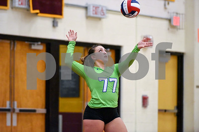 10/18/17  Wesley Bunnell | Staff  Berlin girls volleyball vs New Britain on Wednesday evening at New Britain High School. Berlin's Libby Aroian (77) serves.