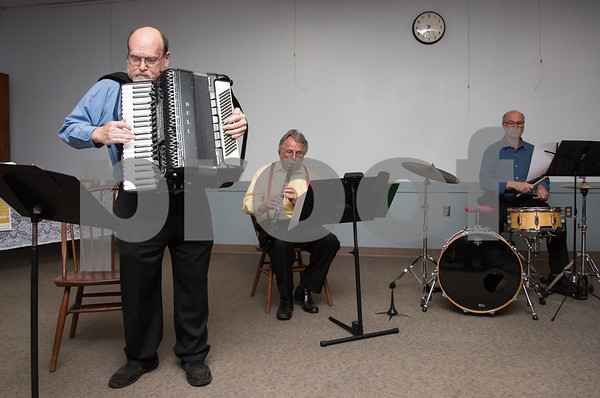10/18/17 Wesley Bunnell | Staff The New Britain Symphony Orchestra Polka Ensemble played for a large crowd at the Berlin Public Library on Wednesday evening. Michael Schiano on the accordion, Walter Mamlok on clarinet and David Edricks on percussion.