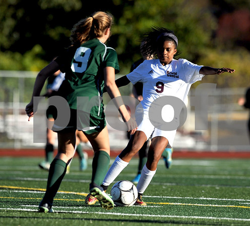 10/18/2017 Mike Orazzi | Staff Maloney's Kyra Milloy (9) and Bristol Central's Mia Hinton (9) during soccer in Bristol Wednesday.