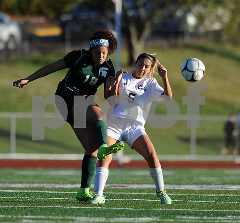 10/18/2017 Mike Orazzi | Staff Maloney's Avery Graham (18) and Bristol Central's Selena Norton (5) during soccer in Bristol Wednesday.