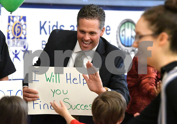 10/19/2017 Mike Orazzi | Staff Greene-HIlls School Principal Scott Gaudet greets students during a Tunnel of Hope assembly Thursday in Bristol.