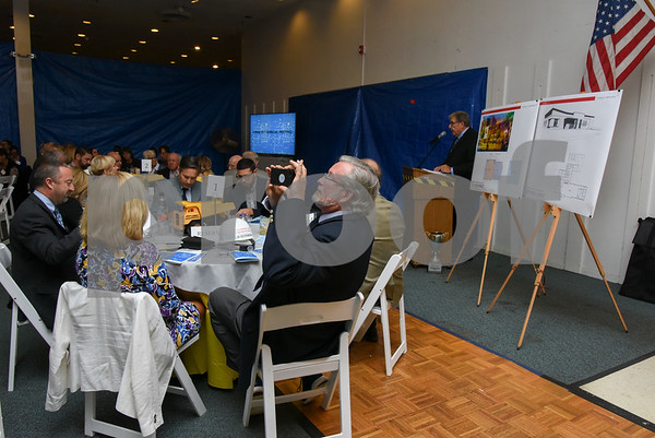 10/19/17 Wesley Bunnell | Staff CMHA held their annual meeting at their new location on Main St. across from Central Park in downtown New Britain. Representative William Petit Jr. takes a photo of the attendees at CMHA President Ray Gorman speaks in the background.