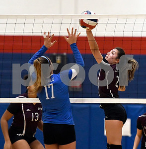 10/19/2017 Mike Orazzi | Staff Plainville's Katharine Tanguay (17) and Bristol Central's Amanda St. Pierre (2) during Thursday's volleyball match in Plainville.