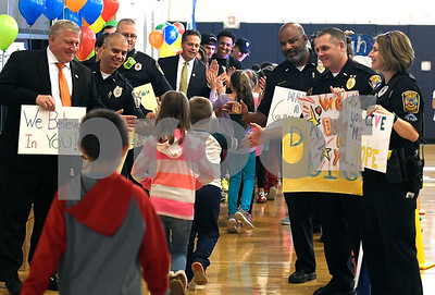 10/19/2017 Mike Orazzi | Staff Greene-HIlls School students are greeted by Bristol Mayor Ken Cockayne, police officers and members of the fire department during a Tunnel of Hope assembly Thursday in Bristol.