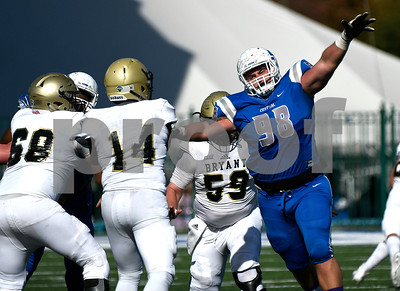10/21/2017 Mike Orazzi | Staff CCSU's Landon Reecher (98) pressures Bryant QB Prince Wilson (14) during Saturday's football game at Arute Field in New Britain.