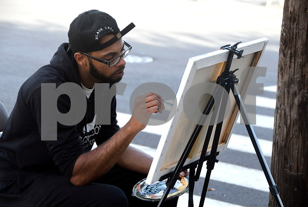 10/21/2017 Mike Orazzi | Staff Jordan Jones works on a painting during a block party in the area of Church and East Streets Saturday afternoon in New Britain.