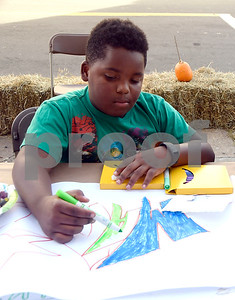 10/21/2017 Mike Orazzi | Staff Amari Crawley works on a drawing during a block party in the area of Church and East Streets Saturday afternoon in New Britain.