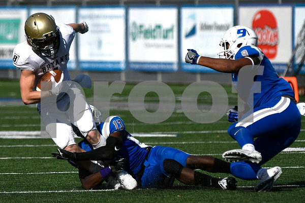 10/21/2017 Mike Orazzi | Staff CCSU's Najae Brown (13) and Kenneth Keen (9) and Bryant's Matt Sewall (1) during Saturday's football game at Arute Field in New Britain.