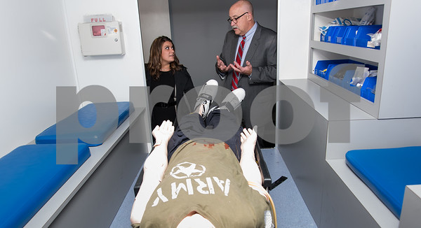10/24/17 Wesley Bunnell | Staff New Britain EMS held a ribbon cutting for its new expanded location at 1 Herald Square on Tuesday evening. Mayor Erin Stewart, L, listens as New Britain EMS CEO Bruce Baxter explains the ambulance simulation room.
