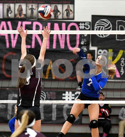 10/26/2017 Mike Orazzi | Staff Bristol Central's Ashleigh Clark (9) and Bristol Eastern's Zoe Lowe (7) at the net during Thursday night's volleyball match at BC.