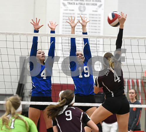 10/26/2017 Mike Orazzi | Staff Bristol Central's Andreia DeAngelo (4) and Bristol Eastern's Olivia Beaudoin (4) and Amber Blais (19) during Thursday night's volleyball match at BC.