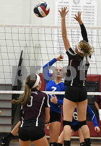 10/26/2017 Mike Orazzi | Staff Bristol Central's Ashleigh Clark (9) and Andreia DeAngelo (4) at the net with Bristol Eastern's Zoe Lowe (7) during Thursday night's volleyball match at BC.