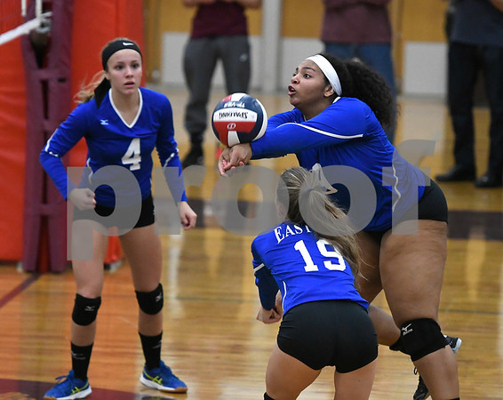 10/26/2017 Mike Orazzi | Staff Bristol Eastern's Sienna White (9) Olivia Beaudoin (4) and Amber Blais (19) during Thursday night's volleyball match at BC.