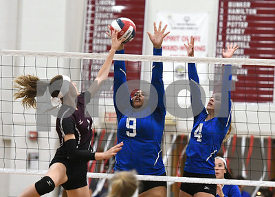 10/26/2017 Mike Orazzi | Staff Bristol Central's Andreia DeAngelo (4) and Bristol Eastern's Sienna White (9) and Olivia Beaudoin (4) during Thursday night's volleyball match at BC.