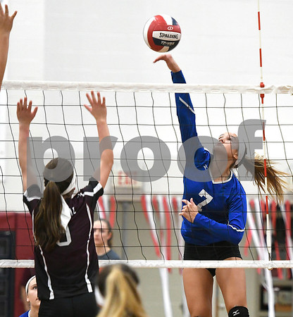 10/26/2017 Mike Orazzi | Staff Bristol Central's Taylor Soucy (3) and Bristol Eastern's Zoe Lowe (7) during Thursday night's volleyball match at BC.