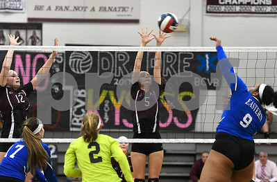 10/26/2017 Mike Orazzi | Staff Bristol Eastern's Sienna White (9) and Bristol Central's Kathryn Ross (12) and Brianna Saverino (5) during Thursday night's volleyball match at BC.