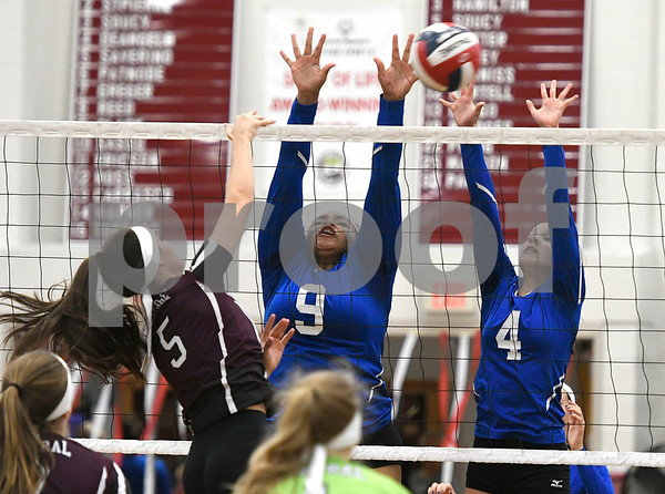 10/26/2017 Mike Orazzi | Staff Bristol Central's Brianna Saverino (5) and Bristol Eastern's Sienna White (9) and Olivia Beaudoin (4) during Thursday night's volleyball match at BC.