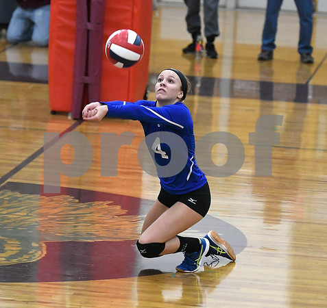 10/26/2017 Mike Orazzi | Staff Bristol Eastern's Olivia Beaudoin (4) during Thursday night's volleyball match at BC.