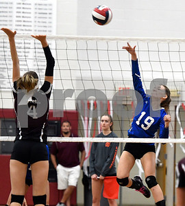 10/26/2017 Mike Orazzi | Staff Bristol Central's Andreia DeAngelo (4) and Bristol Eastern's Amber Blais (19) during Thursday night's volleyball match at BC.