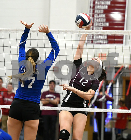 10/26/2017 Mike Orazzi | Staff Bristol Eastern's Gabriella Nozzolillo (17) and Bristol Central's Kathryn Ross (12) during Thursday night's volleyball match at BC.