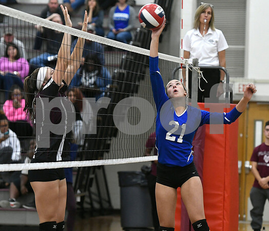 10/26/2017 Mike Orazzi | Staff Bristol Central's Kathryn Ross (12) and Bristol Eastern's Aliana Rivoira (21) during Thursday night's volleyball match at BC.