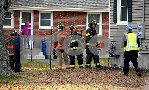 10/26/2017 Mike Orazzi | Staff Bristol firefighters on scene after a man crashed a truck into house hitting a gas meter on Rollinson Road in Bristol's Zbikowski Park Thursday.