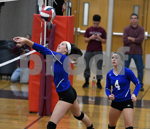 10/26/2017 Mike Orazzi | Staff Bristol Eastern's Aliana Rivoira (21) and Olivia Beaudoin (4) during Thursday night's volleyball match at BC.