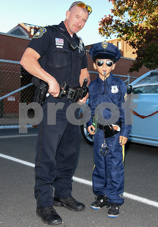 10/27/17 Wesley Bunnell | Staff The Foster Care Unit & Fatherhood Leadership Team of the State of CT Department of Children and Families held a trunk-or-treat for children on Friday evening with volunteers in costume and passing out candy from decorated cars. New Britain Ofc. Brian Solek stands next to Samuel Rivera dressed as a policeman.