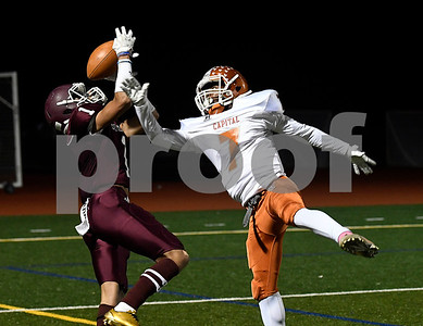 10/27/2017 MIke Orazzi | Staff Bristol Central's Nigel West (1) hauls in a pass while defended by CapitalPrep/Achievement's John Edwards (7) at BC Friday night.