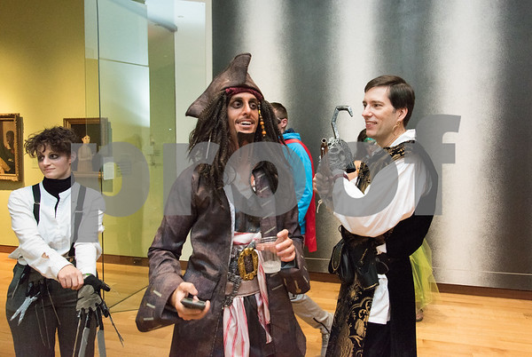 10/27/17 Wesley Bunnell | Staff The New Britain Museum of American Art held their Museum After Dark 11th Annual Halloween Bash on Friday evening. Captain Jack Sparrow Chazz Logue, L, is greeted by a fellow buccaneer.